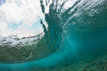 Wave breaking from underwater on section of Glover Reef, Belize — Stock Photo