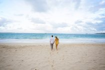 Engaged couple portrait on the beach at North Shore Oahu Hawaii in the Spring. — Stock Photo