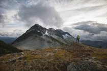 A backpacker takes in the view of Coquihalla Mountain. — Stock Photo