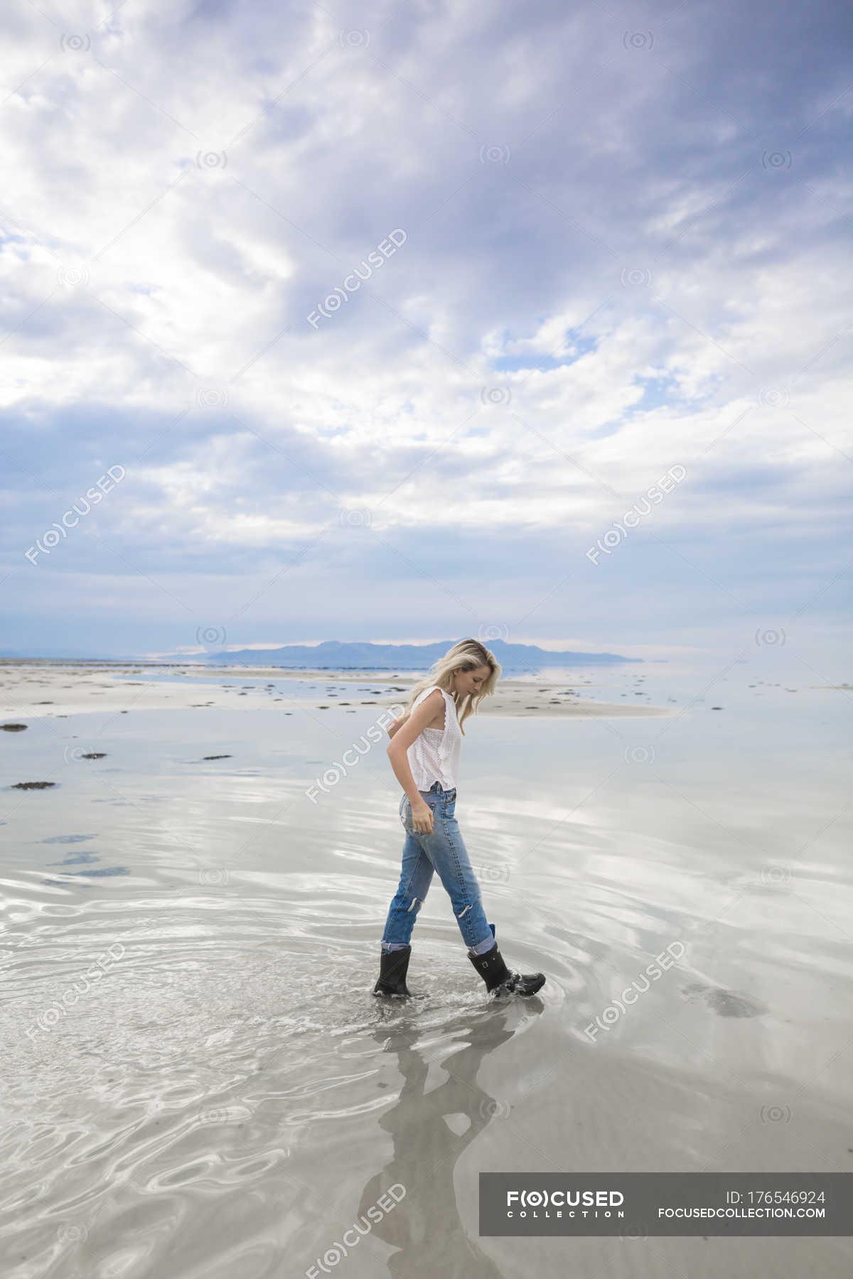 Young Woman Walking In Desert And Great Salt Lake Of Utah