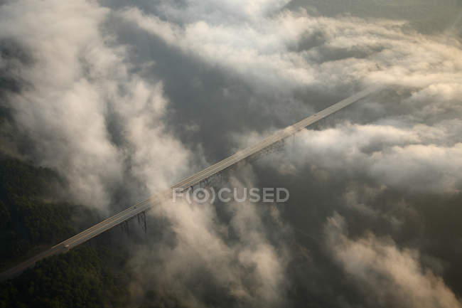 Aerial view of the fog-shrouded New River Gorge bridge at sunrise near Fayetteville, WV — Stock Photo