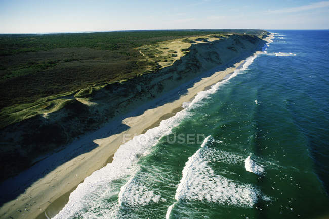 Sets of waves break on the sandy shores of Cape Cod's outer beach — Stock Photo