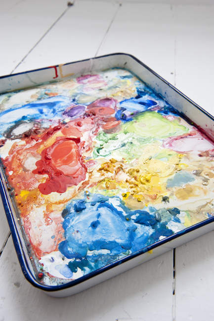 Close up view of watercolor colorful palette on white wooden surface — Stock Photo