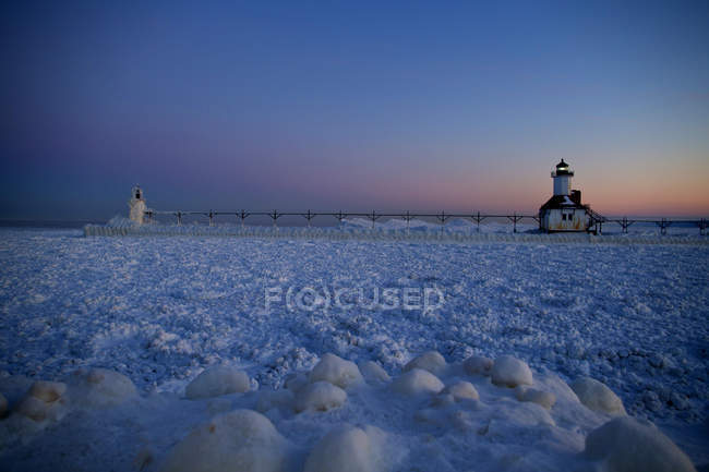 St  Joseph, Michigan, lighthouse is frozen on the shores of