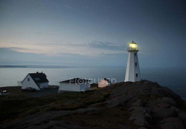 Coastline and a lighthouse from Cape Spear near St. Johns, Newfoundland, Canada — Stock Photo