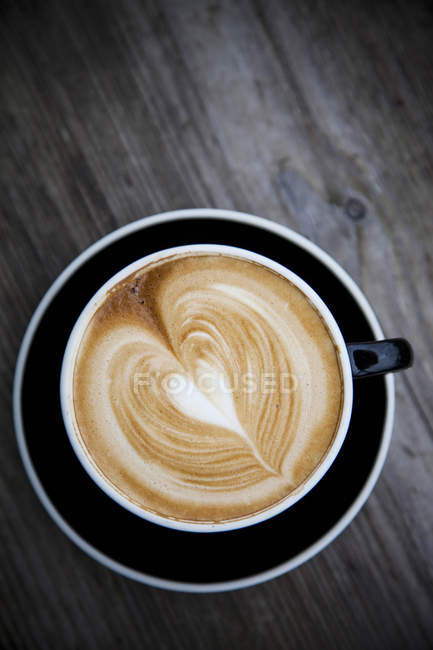 Top view of latte with heart shaped foam — Stock Photo