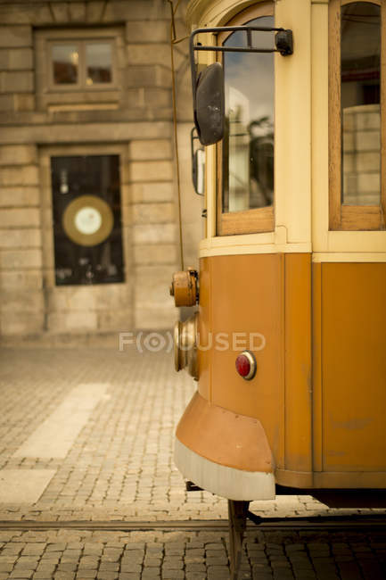 Old trolley of Porto waits for its riders in Portugal on a cobblestone street — Stock Photo