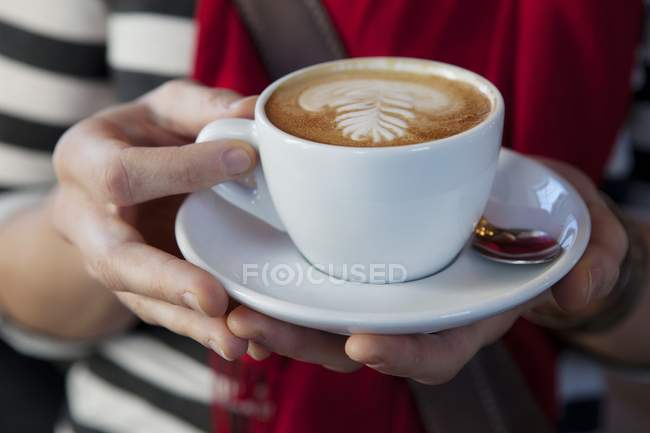 Close-up shot of woman holding cup of coffee — Stock Photo