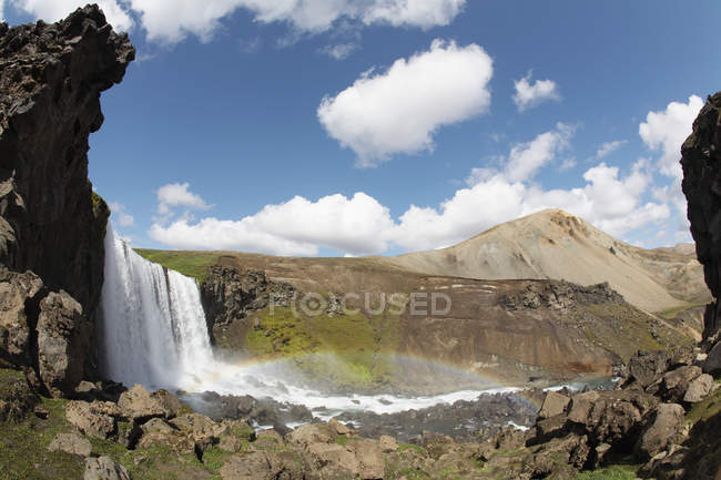 Scenic view of nameless waterfall on Fjallabak and rainbow, Icelandic highlands — Stock Photo