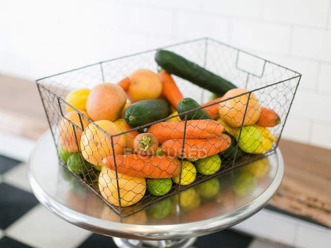 Basket with various fresh fruits and vegetables — Stock Photo