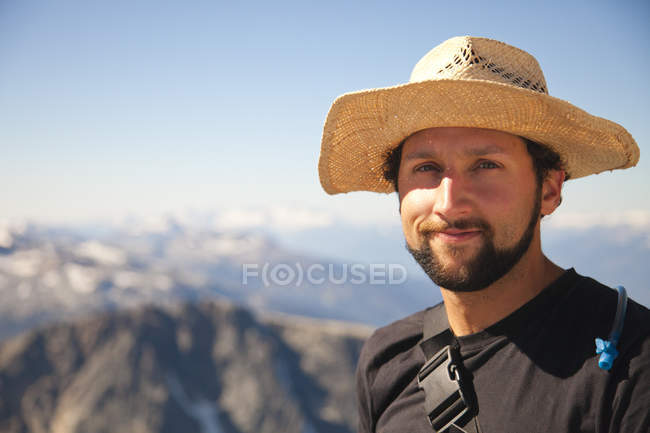 Portrait of a hiker wearing a straw hat. — Stock Photo