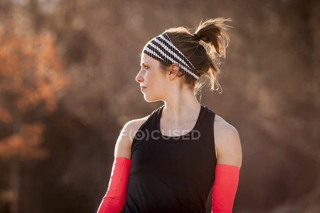 Young woman in sport clothing looking away — Stock Photo