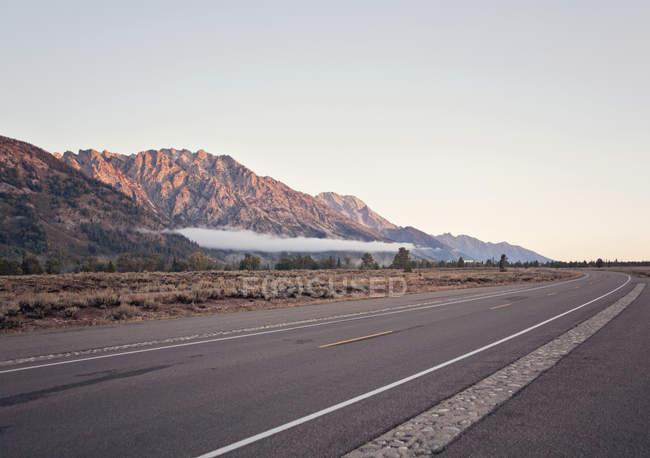 Sole del mattino sfiora il top della gamma di Teton, Wyoming — Foto stock