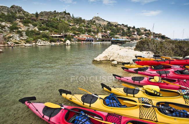 Line of colorful sea kayaks at Kekova Island off the coast of Turkey — Stock Photo