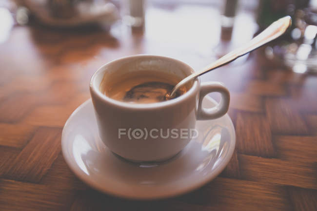 Close-up shot of silver spoon in cup of cuban coffee — Stock Photo