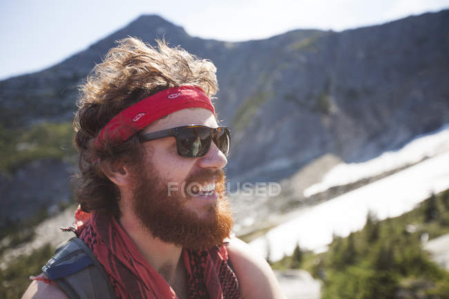 Portrait of Evan Howard, a climber and explorer, wearing a bandana and sporting a thick beard. — Stock Photo
