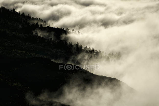 Silhouette Of Mountain Top Amongst Clouds In Teide National Park — Stock Photo