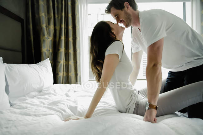 Young Cute Couple Touches Nose To Nose In Hotel Room — Stock Photo