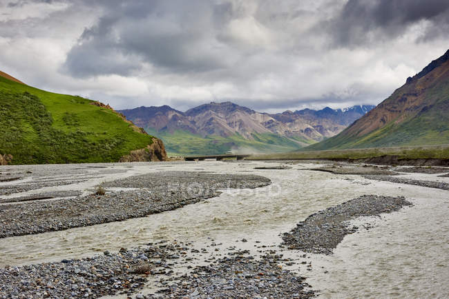 View Of A River Against storm cloud At Denali National Park, Alaska — стоковое фото
