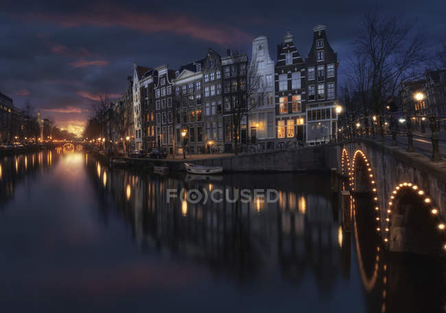 Observing view of Illuminated Bridge Over River In Amsterdam — Stock Photo