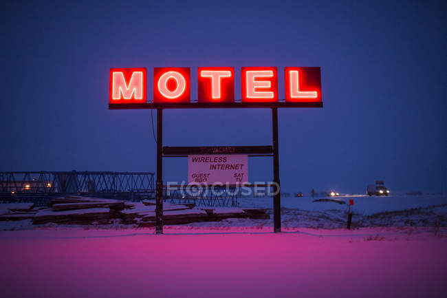 Neon Motel Sign Lit Up In The Dead Of Winter — Stock Photo