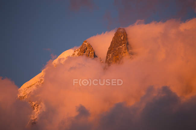Pink evening light on the famous Drus mountain, as seen from Chamonix — Stock Photo