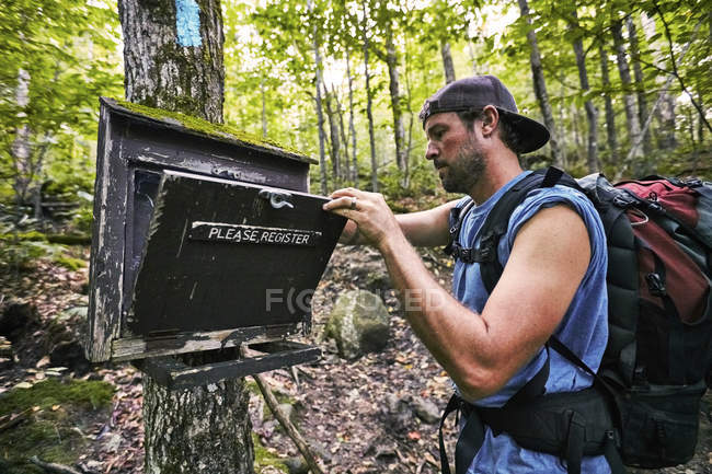 A Man Looking Inside The Register Box At Appalachian Trail — Stock Photo