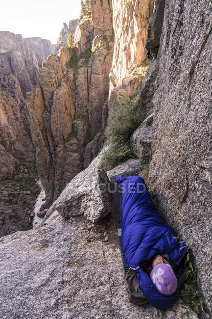 A woman waking up after a bivi on the Two Boulder Bivi, Astrodog,South Chasm View Wall, Black Canyon of the Gunnison, Montrose, Colorado. — Stock Photo