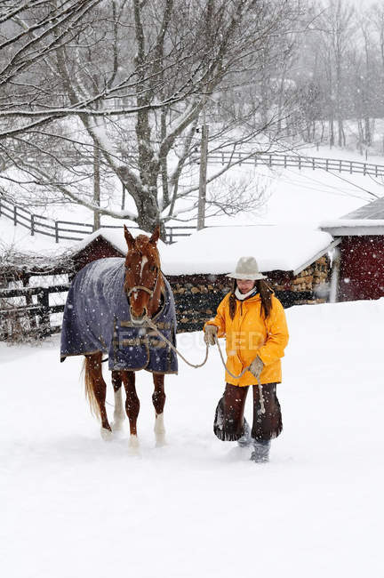 Woman Standing With Horse In Snowy Landscape — Stock Photo