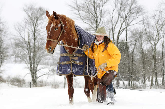 Woman Walking With Horse In Snow — Stock Photo