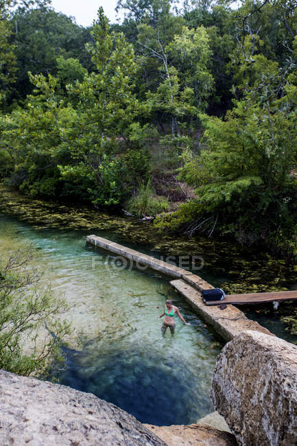 High angle view of woman standing in lake — Photo de stock