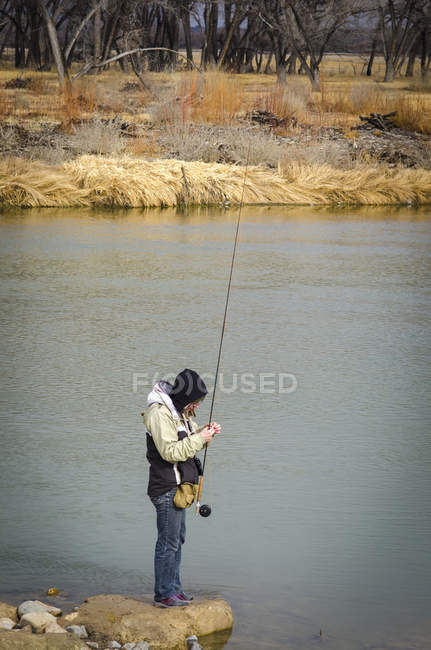 Side view of woman fly fishing on San Juan River, New Mexico — Stock Photo