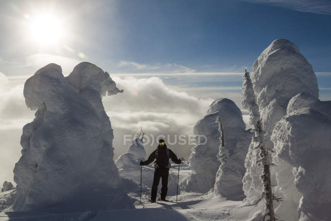 Snowshoeing through snow-covered trees on Big White Mountain, British Columbia, Canada — Stock Photo