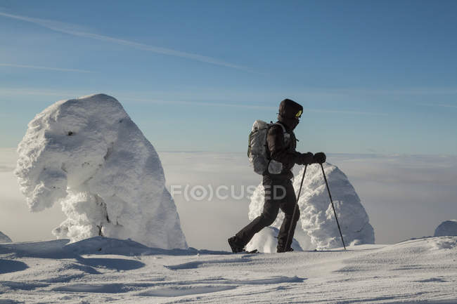 Snowshoeing by snow-covered trees on Big White Mountain, British Columbia, Canada — Stock Photo