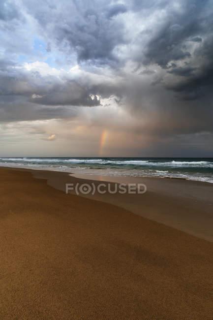 Beautiful beach and ocean landscape with rainbow, Sunrise Beach, Queensland, Australia — Stock Photo