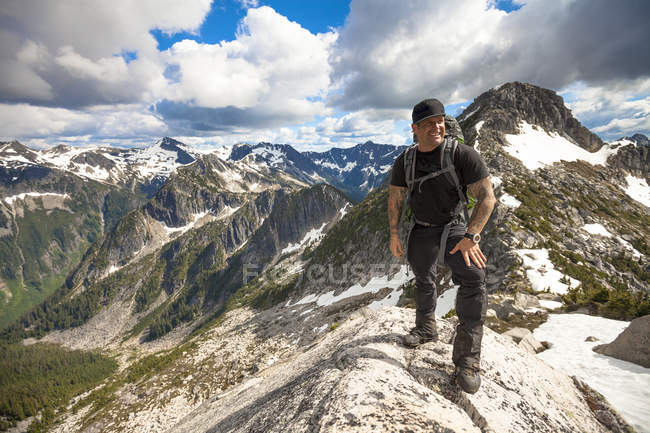 Photograph with portrait of single mountaineer standing in North Cascade mountains, Chilliwack, British Columbia, Canada — Stock Photo
