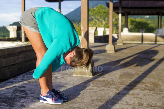 Young woman doing yoga in outdoor — Stock Photo