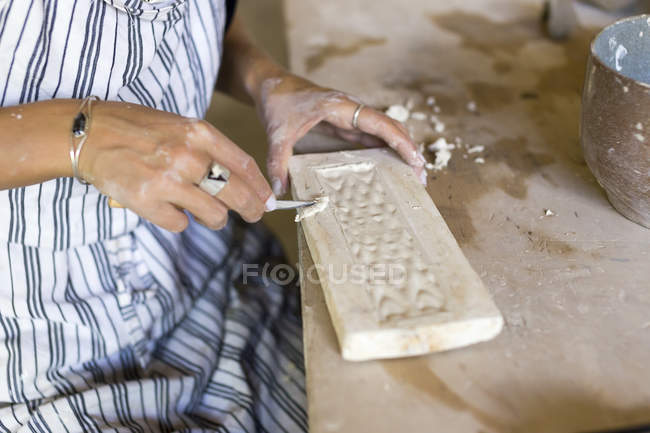 Close up of woman working with ceramic in workshop — Stock Photo