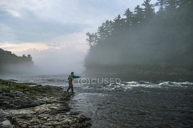 Fly Fisherman Casting Into The Foggy Evening At Kennebec River, Maine — Stock Photo