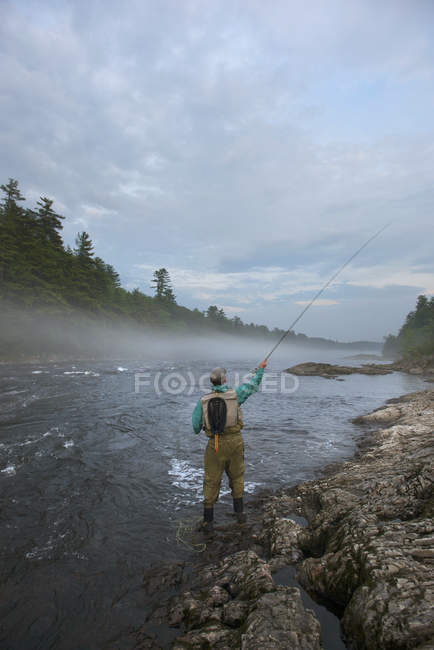 Rear View Of A Fly Fisherman Fishing At Kennebec River, Maine — Stock Photo
