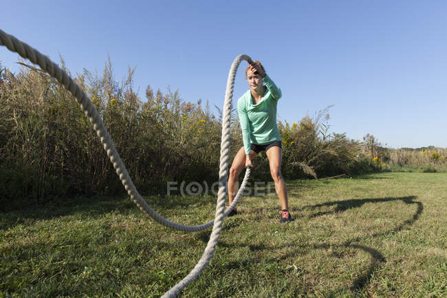 Woman With Ropes Working Out On Grass — Stock Photo