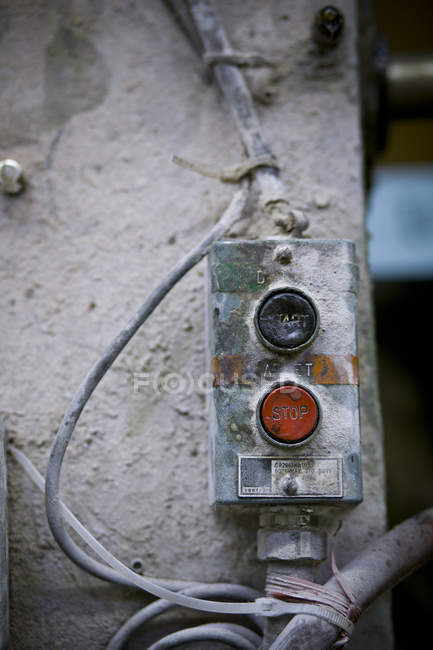 Dusty start and stop switch at a factory in Drummondville, Quebec, Canada — Stock Photo