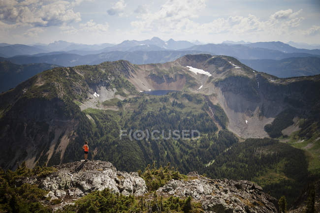 Top view of mountains, woman looking at view — Stock Photo