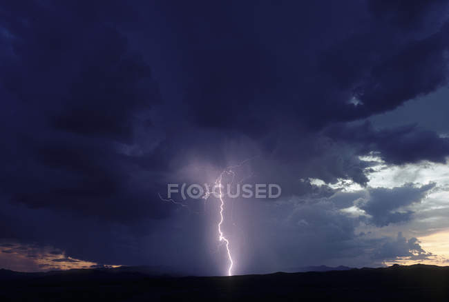 Lightning storms in dramatic evening sky — Stock Photo