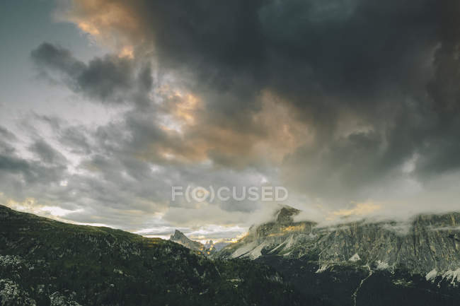 Dolomites mountains under stormy clouds in sky — Stock Photo