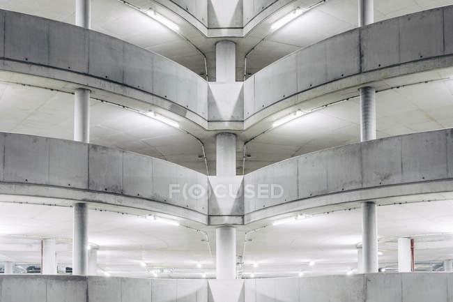 Illuminated parking garage concrete structure at night, Hamburg, Germany — Stock Photo