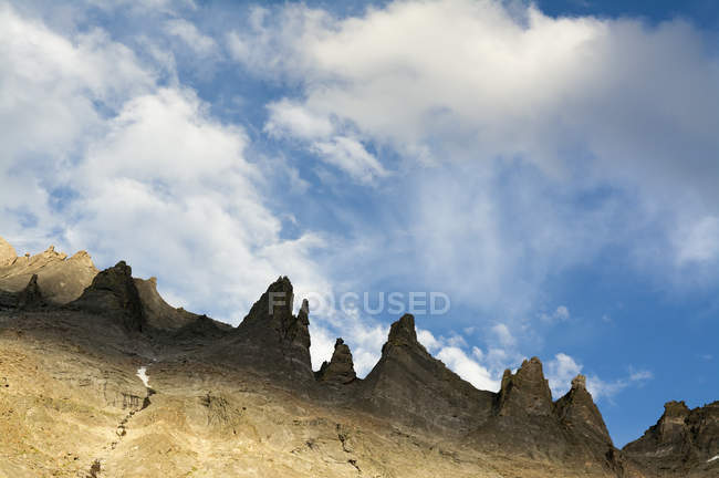 Sunset on granite spires above Glacier Gorge rocks — Stock Photo
