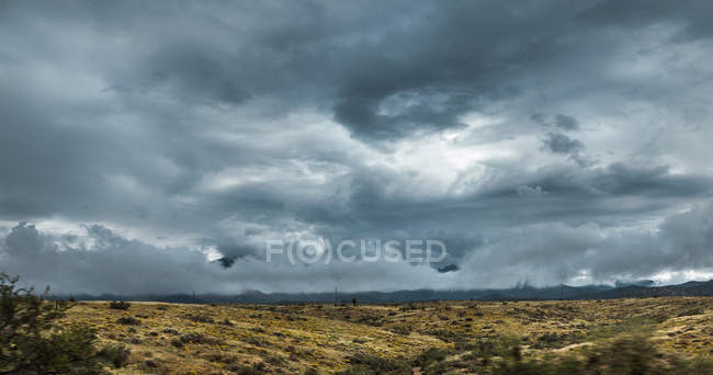 Dramatic Storm Clouds Above Dry Land — Stock Photo