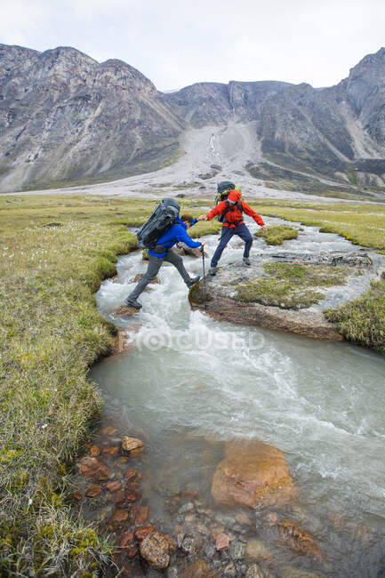 Two male tourists travelling in Baffin Mountains, Canada. — Stock Photo