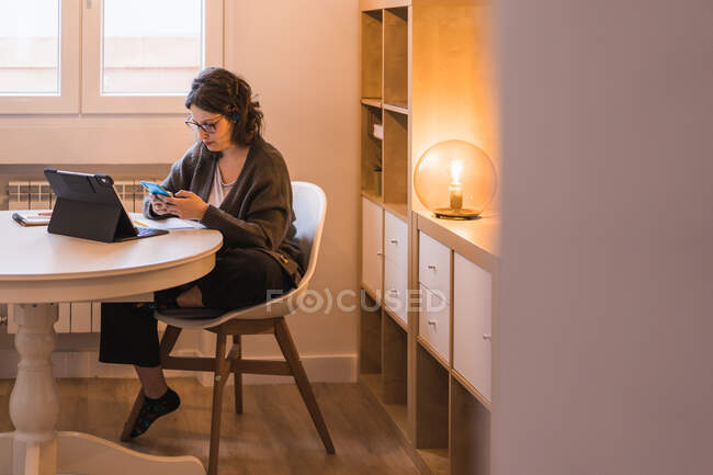 Woman working at home. working with a computer. looking a mobile phone. — Stock Photo